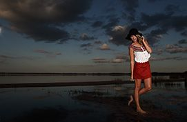 fashion model against florida lake with dramatic lighting