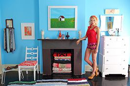 fashion model in red summer clothes posing in blue room