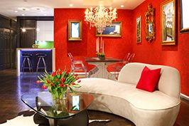 red nyc townhouse living room interior
