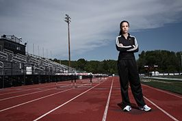 teenager standing on high school track